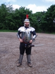 Richard has new and shiny Lorica Segmentata. You know what's really funny? Watching him try to put his greaves on after he's laced himself in.