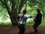 Richard as Abelard Velasquez, moving faster than anyone has a right to in full Lorica.